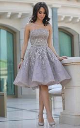 A-line Sleeveless Sequins Strapless Knee-length Homecoming Dress